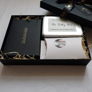 Chocolate gift hamper packed with box of chocolates a chocolate slab a hot chocolate and marshmallow